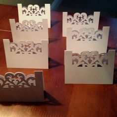 Seating place cards. I made them using white card stock and a Martha Stewart punch I purchased at Michael's.