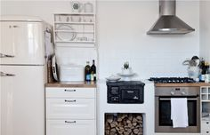 Kitchen, Scandinavian Kitchen With Small Wood Burning Stove: Knowing More Kitchen Stove Paint Scandinavian Kitchen, Kitchen Remodel, Kitchen Design, Portable Kitchen Cabinets, Minimalist Small Kitchens, Kitchen Trends, Small Stove, Kitchen Style, Kitchen Cabinets