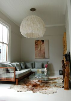 tiny living room  large statement lighting