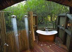 A gorgeous outdoor bathroom, with the addition of a lush bathtub, and the necessary wilderness view.  Khwai River Lodge Botswana