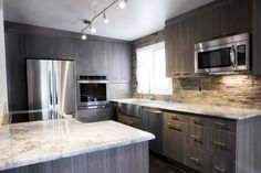 Image from http://dgmagnets.com/wp-content/uploads/2016/05/Amazing-Grey-Kitchen-Designs-With-Additional-Home-Decoration-Ideas-Designing-with-Grey-Kitchen-Designs.jpg.