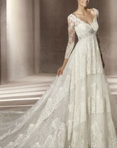 Long Sleeve Lace Wedding Dress  http://www.weddingdressesday.com/admirable-glamorous-vneck-long-sleeves-beadings-corest-satin-overlay-lace-cathedral-train-wedding-dress-dwd099-p-53.html