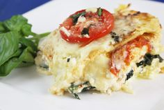Layers of noodles stuffed with ricotta cheese, sauteed garlicky spinach, and roasted tomatoes with a creamy Bechamel, make up my Spinach and Tomato Lasagna.
