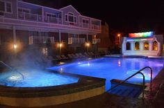 10 Places to Swim Outdoors in New England All Winter: A waterfall feature is turned off after Halloween, but 365 days a year, guests at the Cape Codder Resort on Cape Cod can go for a swim in the Rainbow Falls heated outdoor pool.