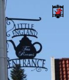 Entrance sign for Little England Tea Rooms in Norway. Text and image cut in 5mm plate in a hand forged frame. Stands 1 metre high on the wall.