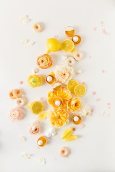 Gorgeous yellow flatlay food photography with lemons passion fruit tarts mini cake donuts and flowers. Hey There Cupcake + Cavin Elizabeth Photography