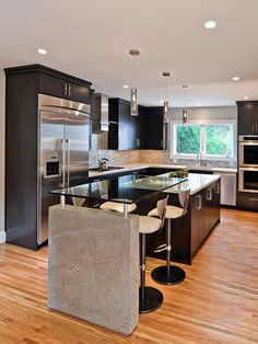 Sleek Contemporary Kitchen | Mary Beth Hartgrove | HGTV  Cabinets shortened, room near stove