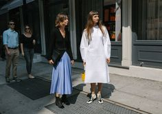 Annina Mislin and Brie Welch in a Tibi dress with a Simon Miller bag