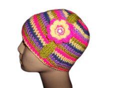 Плетена шапка за малки и големи.  Шапката е изплетена от 100 % акрилна прежда.  Много мека и топла шапка, която ще ви предаде страхотно настроение през зимните дни.  Може да ви бъде изплетена в различни размери.  От новородено до размер за големи.  Може в съчетание с цвете и без цвете.  Шапката може да се съчетае с един прекрасен шал пожелание.