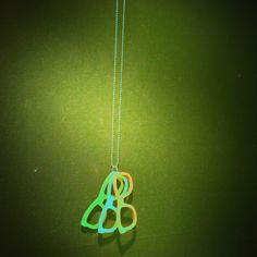Lazer cut frames stained and attached to a ring to Hang from a chain.