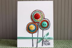 Create Circle Flowers Out of Magazine Pages, Buttons, and a Punch Tool: Circle + Button Flowers