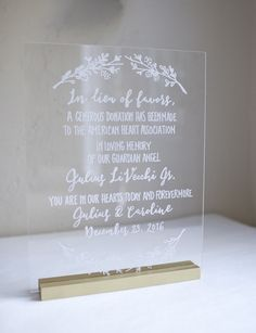 In lieu of favors sign on clear acrylic. Custom designed with gold wood stand. Hand painted. Etsy weddings