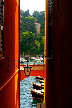 Portofino, Italy - Portofino is a small Liguirian fishing village in which no new houses have been build since 1935. Peaking thru to the bustling harbor all offset by staggering scenery, it makes for an  irresistible retreat, and one that over the years has attracted writer Truman Capote and the glamorous Hollywood stars, including Liz Taylor, Richard Burton, Humphrey Bogart and Clark Gable.   http://www.pointsandtravel.com/treat-suite-life-hotel-splendido-portofino-italy/