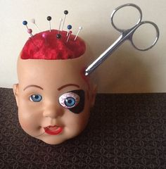 Dollhead Pin Cushion | 20 Creepy Things You Can Find OnEtsy