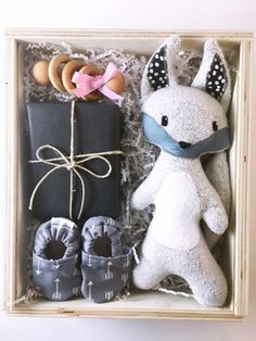 The NC Babe Box Deluxe  Curated baby gift box   Made in North Carolina products, including Chapel Hill Toffee, wooden rattle, baby booties and stuffed coyote in a slide top pine box