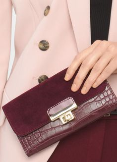 Sumptuous suede is placed along the foldover element of this dark burgundy wallet. By simply attaching its strap, our wallet instantly converts to wristlet. | White House Black Market