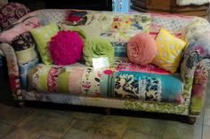 my mom would die over this couch covered in old quilts