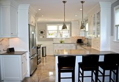 William Adams Design: High end kitchen design with peninsula bar area. White Shaker style cabinets and gray ...