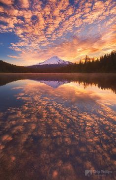 """Mackerel Sky, Trillium Lake""    Mackerel Sky is often seen as the first sign of an approaching weather front and brings summer storms and winter gales.  This is sunrise.  Trillium Lake is in Oregon, SW of Mount Hood."