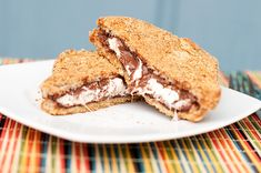 """what about making """"ravioli toast""""? Smores french toast stuffed with nutella, marshmallow fluff and coated in graham crackers, backed Köstliche Desserts, Delicious Desserts, Dessert Recipes, Yummy Food, Graham Crackers, Yummy Treats, Sweet Treats, Chocolate Marshmallows, Chocolate Chips"""