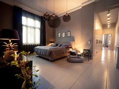 Introducing: our designers Rhea & Janna from Berlin. 19th century apartment with eclectic art deco inspired moody interior. Bedroom. Click to find more inspiration!