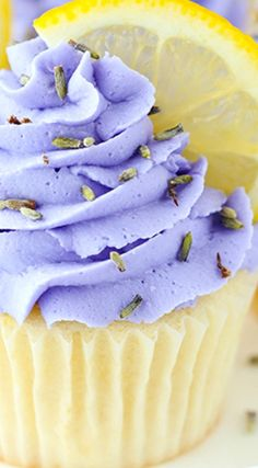 Lemon Lavender Cupcakes ~ Easy lemon cupcakes with lavender buttercream frosting, topped with lavender flowers and fresh lemon slices