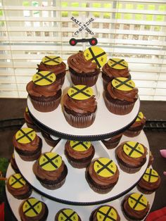 Pipe brown frosting on the cupcakes.  Use yellow fondant and black food marker for the cupcake toppers.