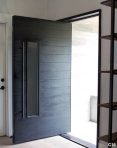 Custom Katti in Mahogany with our Handle & Lockset Package in Black Modern Entry Door, Modern Exterior Doors, Contemporary Front Doors, House Front Door, House Doors, Pivot Doors, Entry Doors, Entry Foyer, Glass Wall Systems