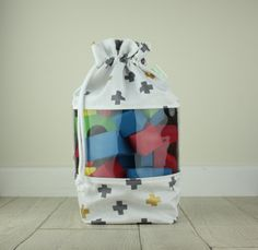 Small Drawstring Toy Storage Bag With See Through Clear Vinyl Panel   Grey  Gold Crosses   Toy Storage | Travel Bag | Gift |