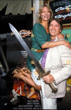 sandahl bergman & arnold Shwarzenagger ~loooove this; great way to capitalize on having a super strong man ;)