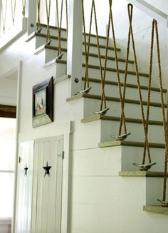 Rope and sailing cleats act as cool coastal bannister. Absolutely LOVE this!