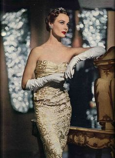 Strapless gold brocade evening gown worn by Lillian Marcuson, 1950