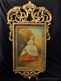 Marco de madera tallada con sobredorados, imagen central de dama detalles en relieve a mano