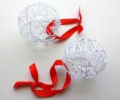 Christmas ornament, yarn/string, glue, glitter, balloon, ribbon