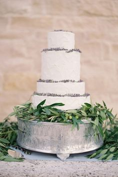 Add a touch of organic whimsy to a simple white cake by wrapping the tiers with pretty lavender.   - HarpersBAZAAR.com