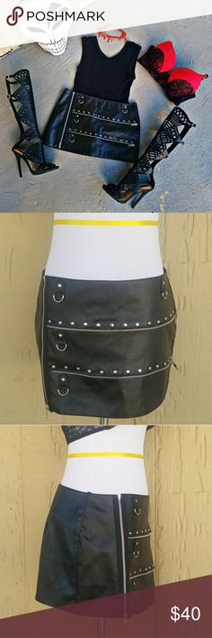 "Black ""Allure Leather"" Faux Leather Skirt Allure Leather metal fetish faux leather skirt. Fully lined and features a zip through side closure, and 4 silver d-rings + 2 silver zip accents.  📐DIMENSIONS📐 (approximate) ⚠COMING SOON⚠  33% Polyurethane 67% Polyester  Color(s): Black / Red [lining] Skirts Mini"
