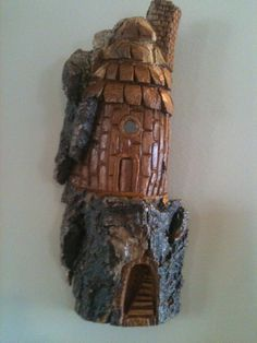 woodcarving out of cottonwood bark a little hobbit house