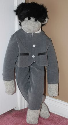A custom made BEATLES monkey.  made by Caroline's Sock Brigade.