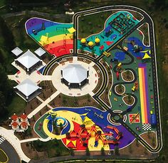 It's like a rainbow of excitement! I want to ride my tricycle on that excellent bike path and jump from color to color! Architecture Blueprints, Landscape Architecture, Landscape Design, Architecture Design, Playground Design, Indoor Playground, Parque Linear, Cool Playgrounds, Creative Kids Rooms