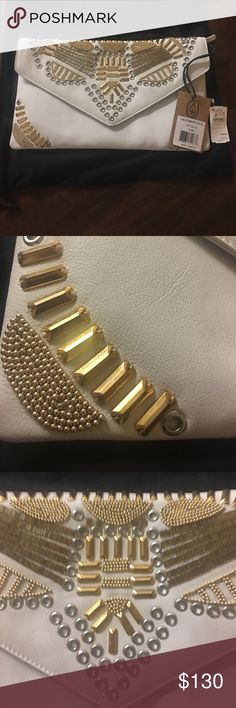 Ash || White Studded Bag I'm selling a absolutely gorgeous leather white clutch new with tags. Was a bit too large for me but a great size for ladies who like larger clutches. Leather has all impressing as pictured in 5th image on the right. Open to offers! Ash Bags
