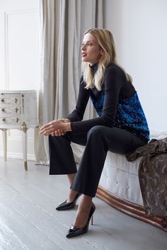 Add some sparkle to your outfit by wearing glitter top on top of your polo-neck.