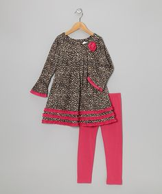 This smooth, stretchy tunic features a wild leopard print outlined with bright fuchsia trim. Simply button it on and pair with the matching knit leggings for a pretty yet practical statement.Includes tunic and leggingsTunic: 95% polyester / 5% spandexLeggings: 65% cotton / 30% polyester / 5% spandex