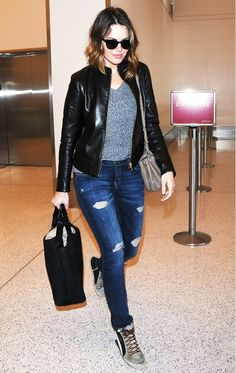 Mandy Moore shows off her casual style in ripped jeans, sneakers, and a striped tee.