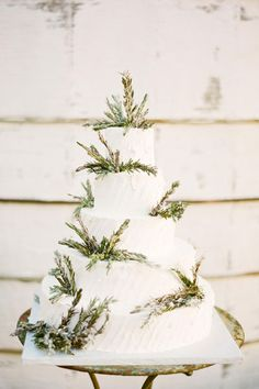 The edibles need décor, too! Place sprigs on the tiers of an all-white cake for a sharp contrast.
