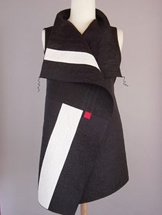 more Juanita Girardin. Her interpretation of japanese patterns is very elegant and modernDraped Collar Vest Blue and Black