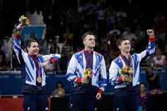 (L-R) Bronze medallists William Bayley of Great Britain, Aaron Mckibbin of Great Britain and Ross Wilson of Great Britain stand on the podium during the medal ceremony for the Men's Team Table Tennis - Classes 6-8 on day 9 of the London 2012 Paralympic Games at ExCel on September 7, 2012 in London, England