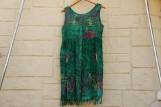 Vintage 90s batik baby doll rayon dress with fringe, in good shape. Made by Island X Hawaii.  Size : Medium-Large  Flat Measurements : Chest : 21 Hips : 30 Length : 38