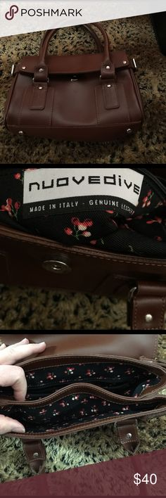 "WOW! Italian leather Nuovedive purse. Brown Italian leather Nuovedive purse.  Two sections.  An interior zipper pocket. Cherry print lining with navy blue background. Two 14"" handles. Purse 9""x 7""  A Must have for any season. Nuovedive Bags"