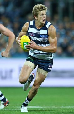 Rhys Stanley Photos - Rhys Stanley of the Geelong Cats runs with the ball during the round three AFL match between the Geelong Cats and the Brisbane Lions at Simonds Stadium on April 2016 in Geelong, Australia. - AFL Rd 3 - Geelong v Brisbane Hot Rugby Players, Tennis Players, All Team, Great Team, Australian Football League, Dynamic Poses, Super Sport, Female Poses, Pose Reference