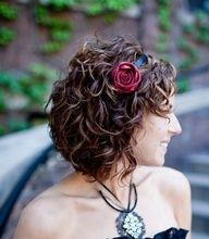 love the flower headband and the short curly hair. :)